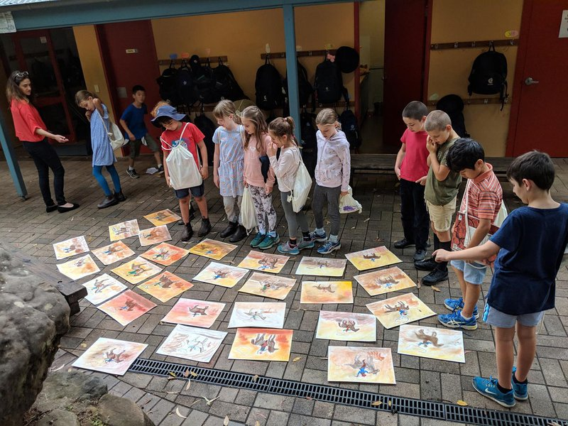 As they make their way, they pass Class 6, whose beautiful chalk pastel drawings are airing