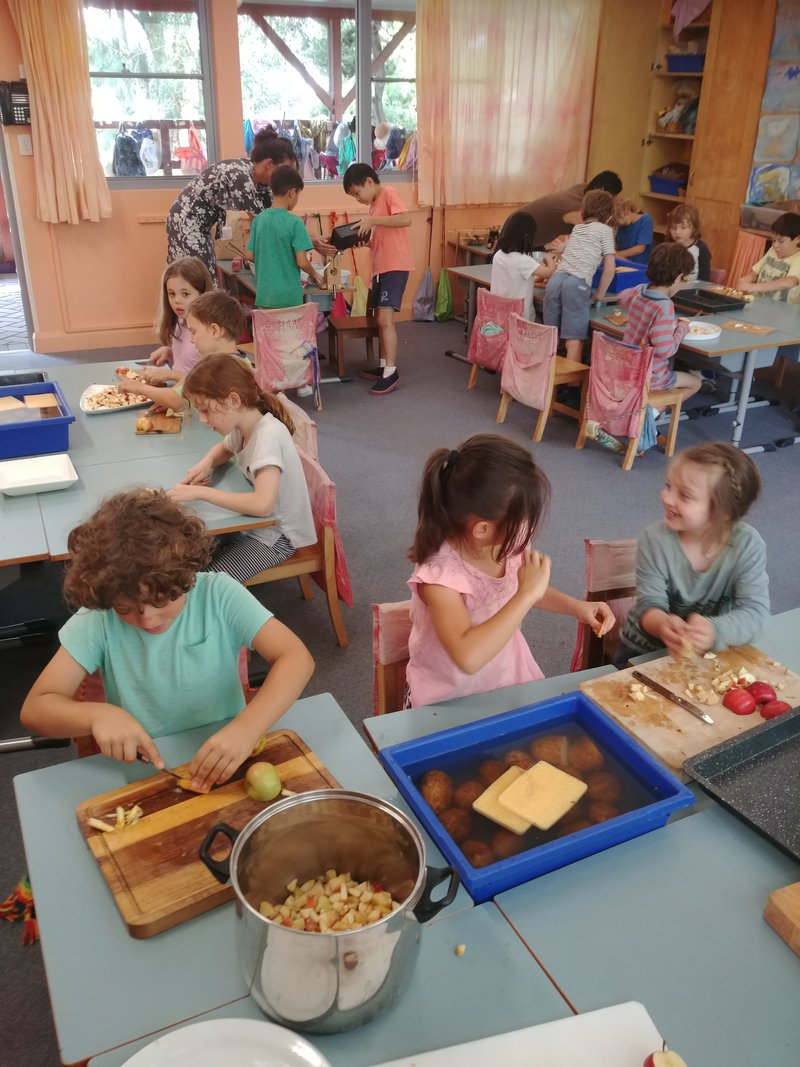 Clss 2 prepares the apple crumble for the Michaelmas feast.
