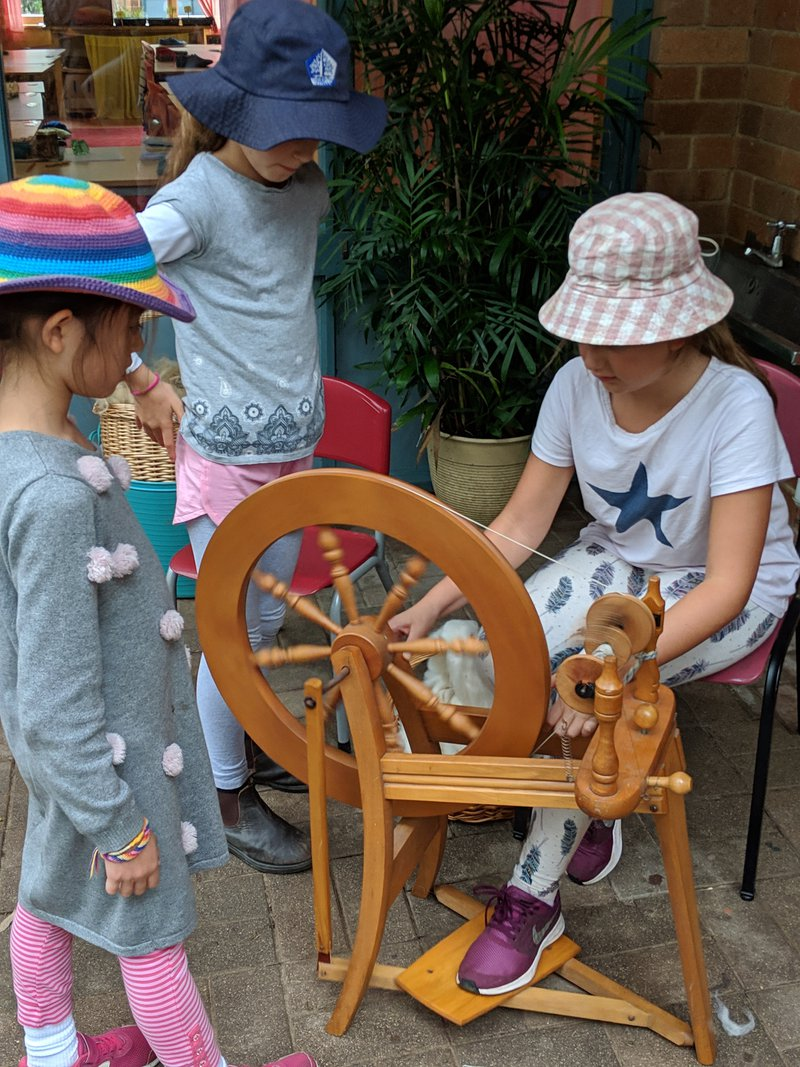 With help they worked out the spinning wheel.... 2 whole balls of wool were made!