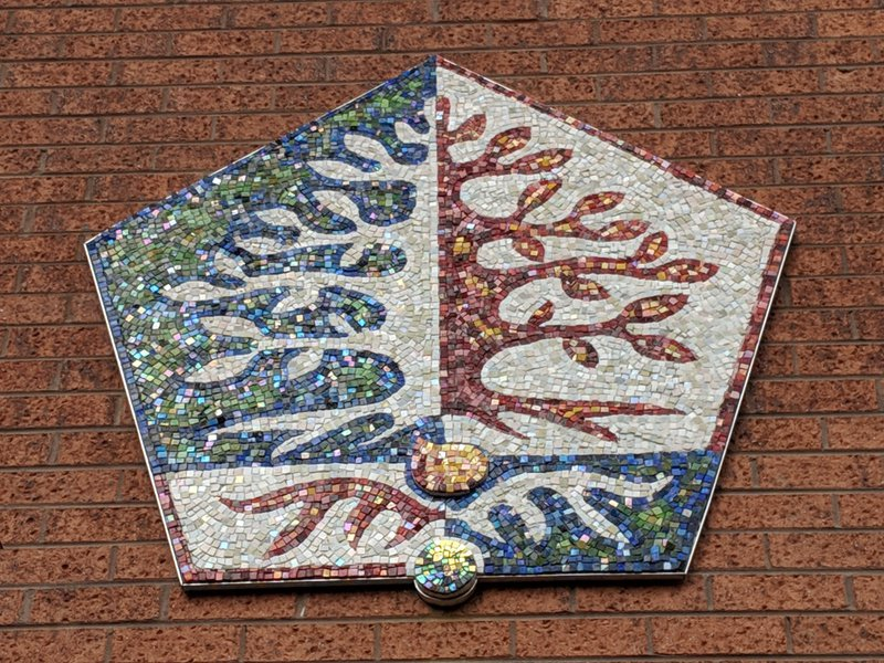 He worked with every student in the school to create this beautiful  mosaic of the school emblem on the Sylvia Brose Hall