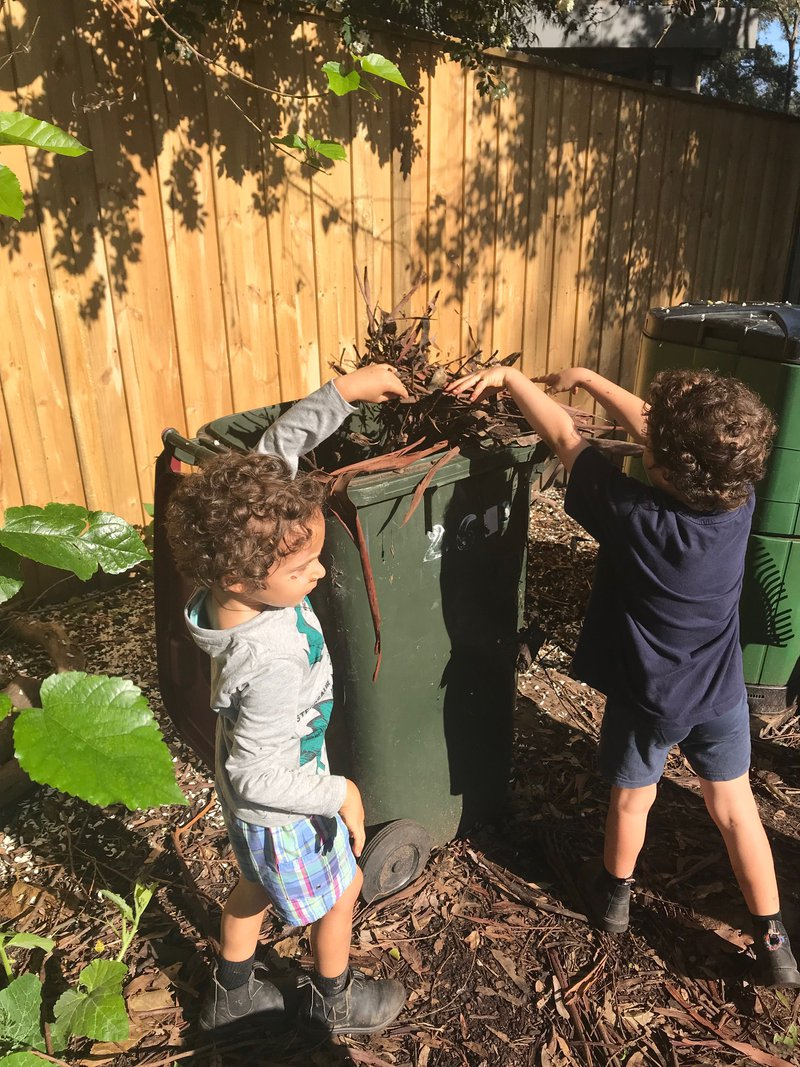 Filing the compost bins!