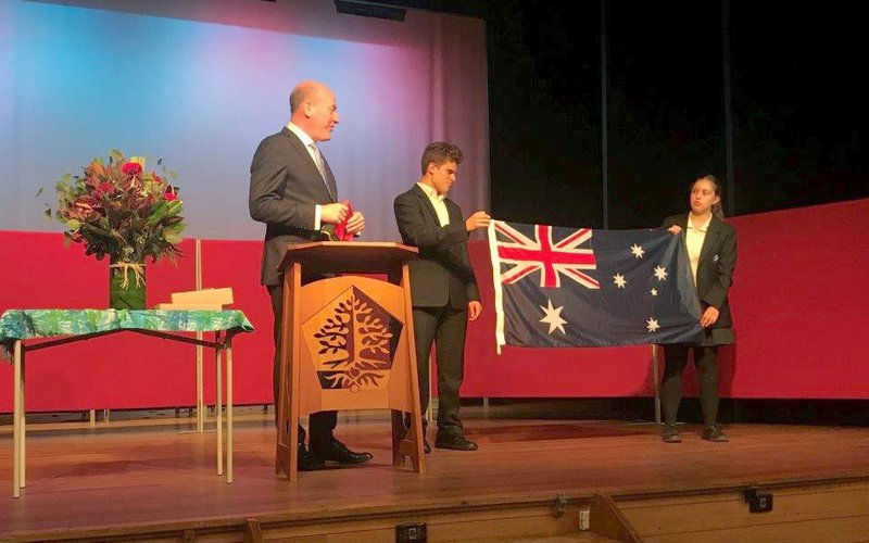 The Australian Flag is presented to Roby Vella and Nelson Whitington-Hall