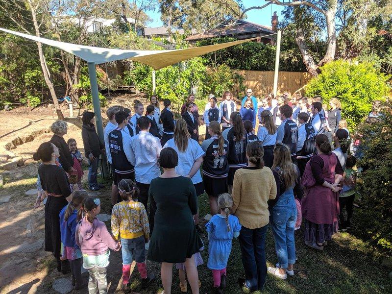 Kindergarten Morning Circle singing to Year 12