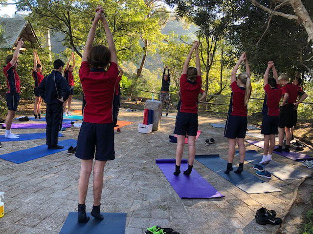 Yoga at sunrise for Year 9s in The Cove