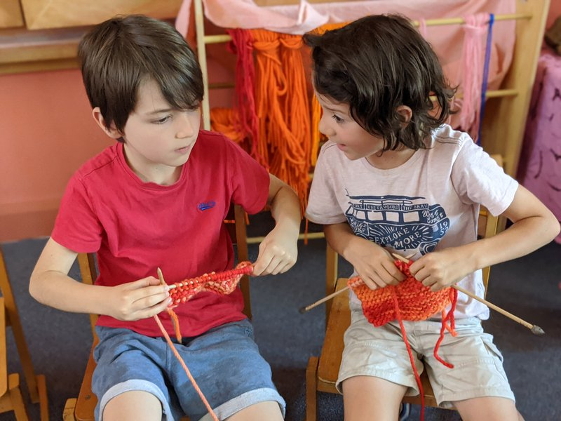 Class 1 learning to knit