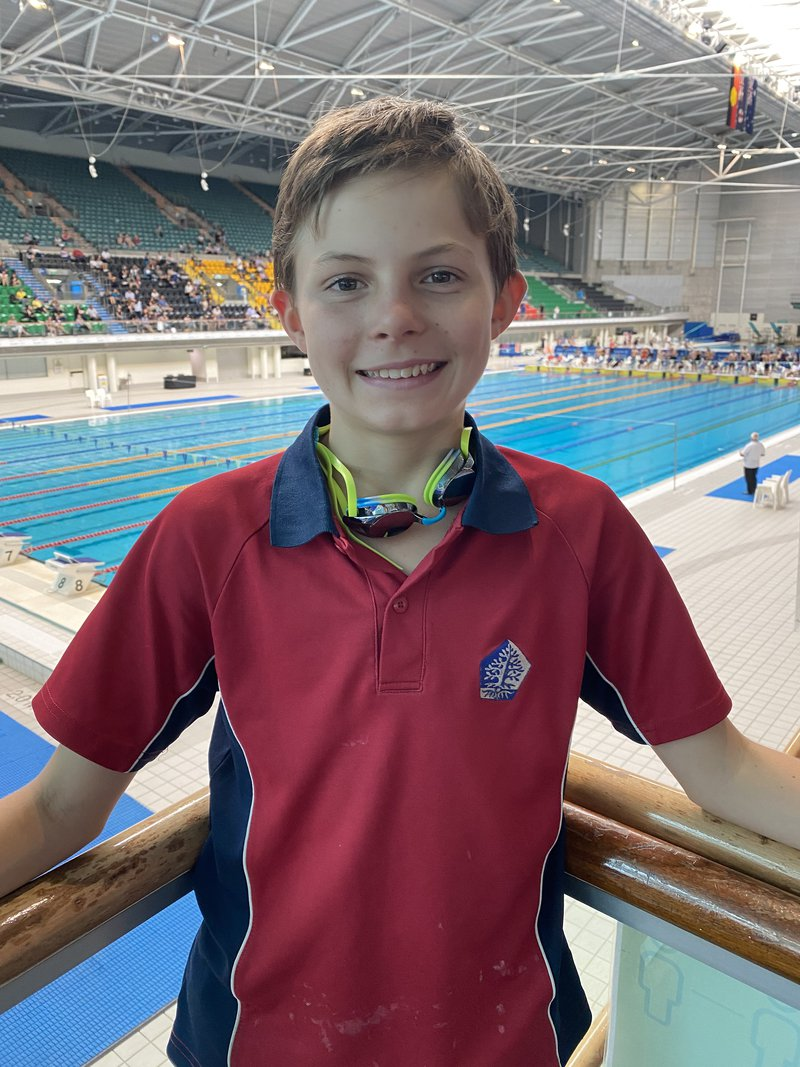 Year 7's Archie swims at the AICES Swimming Championships